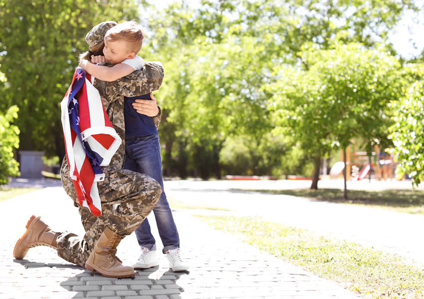 Woman soldier hugging child